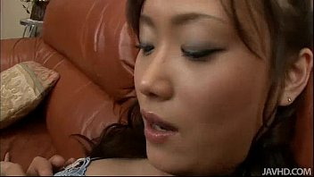 Hitomi Aizawa on couch her stocking clad legs spread wide
