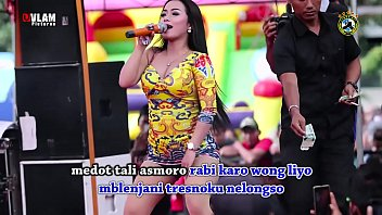 Indonesian Erotic Dance - Two Pretty Singer Wild Dance on stage surrounded by a lot of men