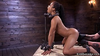 Blindfolded and gagged small tits ebony slave Kira Noir in sitting bondage gets electro shocked then from behind pussy fucked with dick on a stick