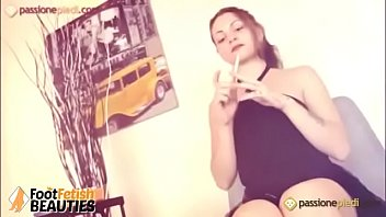 Horny barefoot teen teases you while smoking a cigarette