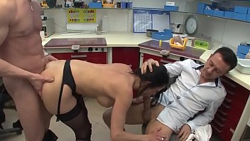 The prosthetic head punishes his two employees by forcing them to fuck him.