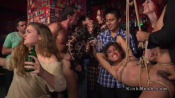 Two slaves orgy banged in public bar