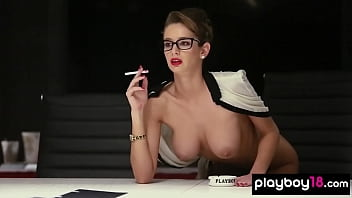 Hot secretary Emily Agnes copying her massive tits in the office