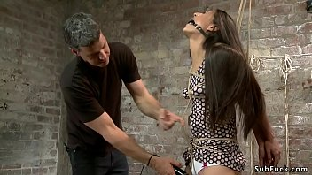 Bound brunette is spanked and toyed