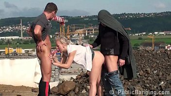 A cute blonde girl is fucked by 2 guys at a construction site