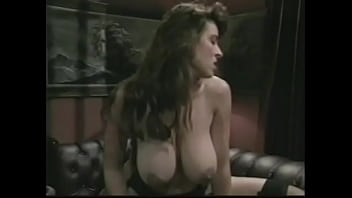 Horny dude is infatuated with popping his cookies on big natural boobs of awesome darkhaired bombshell Christy Canyon after banging her wet pussy