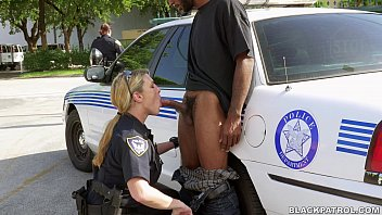 White cops suck black dick in street