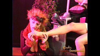 Luscious domina has fun with a blonde hussy and performs a striptease 19 min
