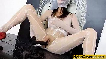 Hot brunette wears nylon mask to distort her face
