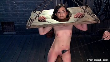 Strapped brunette slave is toyed