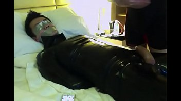 Gay rubber stamps Tape gagged asian sub in rubber suit. being masturbated until he chums.
