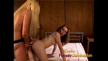 Two luscious lesbian babes use a strap-on to bang each other