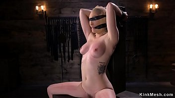 Blonde in doggy bondage gets whip