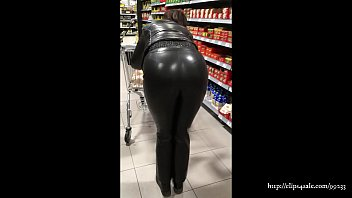 Wife in leather trousers and shiny jacket (video via smartphone)