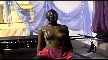 Girl in latex is an object in the hands of her master