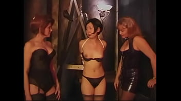 Blonde dominatrix and her assistant train Asian MILF in BDSM chamber
