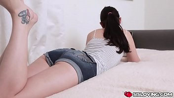 Busty stepsis blows her stepbros dong in the bed while his girlfriend watching TV