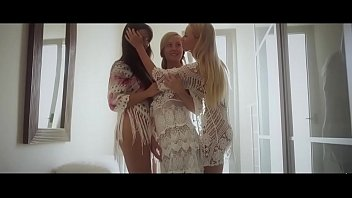Three European lesbian blondes kissing and fingering