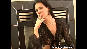 Horny brunette posing sexy while smoking cigerette