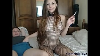 Camgirl in fishnet sucking and smoking
