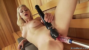Pretty blonde machine fucked in sauna