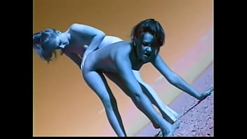 Couple of female aboriginal inhabitants with blue skin from Planet X Alyssa Allure and Heaven Lee perform strange ritual of rain summoning in the desert part