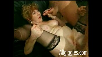 Mature blond Diane Richards takes four cocks