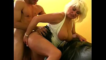 Lecherous cougar Dana Hayes with big jugs enjoys riding big Brown Joe on black leather sofa