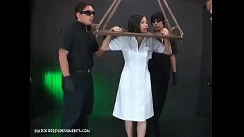 Horny Asian Submissive Bound In Wooden Stocks And Dominated