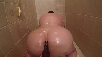 Marcy Diamond getting fucked with a beer bottle in the shower