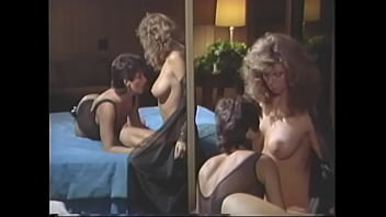 Busty blonde hottie Tracey Adams and slim brunette Sharon Mitchell enjoy talking to the canoe driver with great and good pleasure