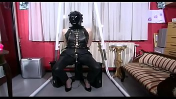 Sexy woman in latex Hot lady in latex and mask