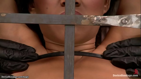 Slave in pile driver bondage whipped