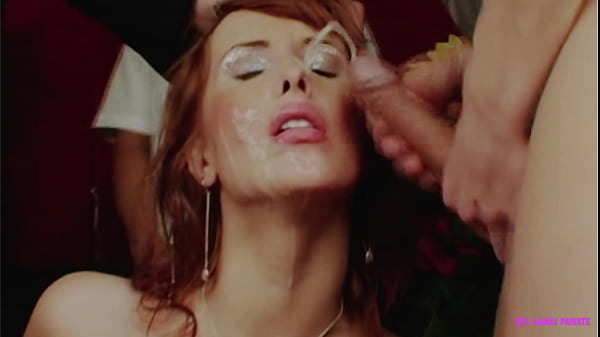 Naughty redhead collects sperm on her face