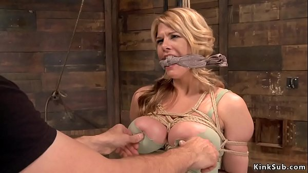Huge tits sub is suspended on hogtie