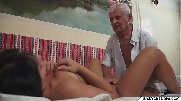 old grandpa makes a picnic with young girl Thumb