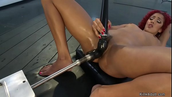 Redhead ebony fucks machine and squirts