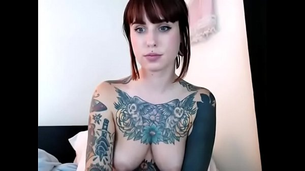 Sexy tattooed camgirl with piercings toys her p...