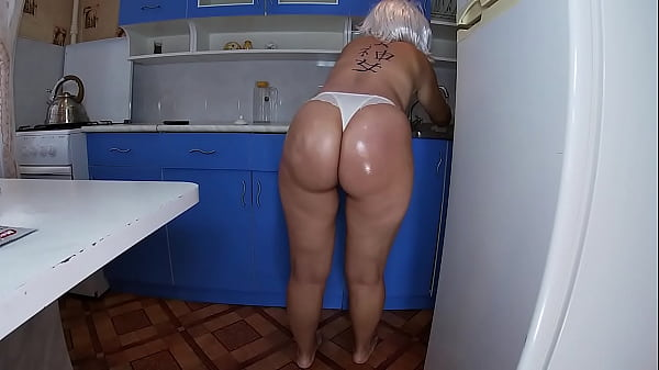 Mom washed the dishes in the kitchen and took the stepson's penis in her hand and inserted it into her anal