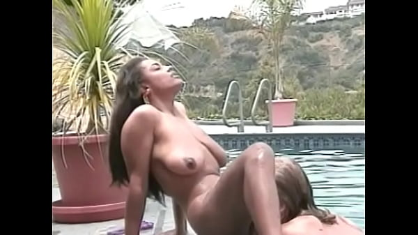 Ebony beauty and lusty blonde finger fuck each other by the pool
