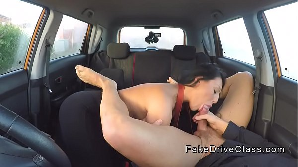 Big tits brunette pounding examiner in car