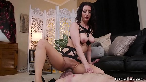 Busty dominatrix gives face sitting