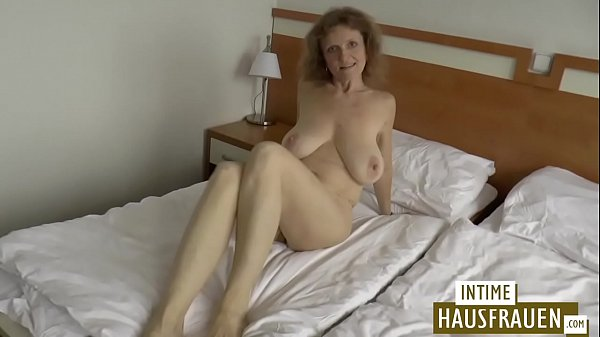 Brunette milf with hanging tits