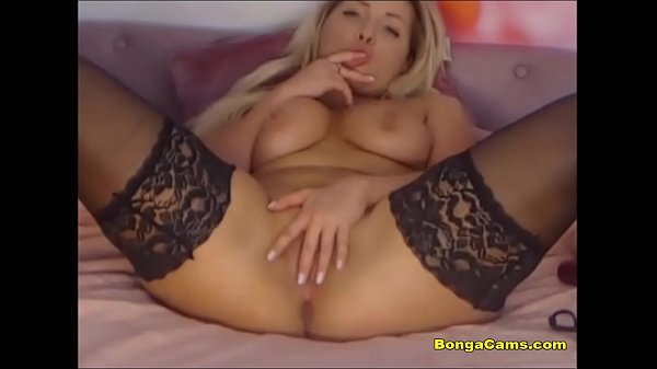 Juicy blond in stockings having fun with toys a...