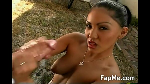 Horny Asian girl rubbing a large dong