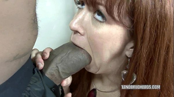 Redhead hottie Trinity Post takes on a huge black cock Thumb