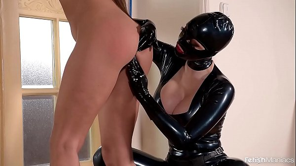 Fetish Queen Latex Lucy Fucks Two Submissive Lesbians With a Strapon Dildo
