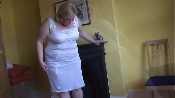 Mature blonde BBW teasing and posing as she cleans