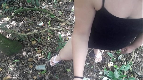 Young girl doing blowjob in the forest