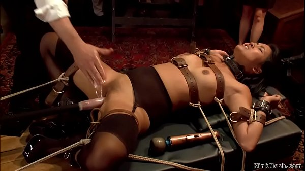 Asian fucks machine at bdsm party